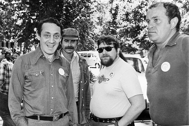 WELCOME TO THE TEXTBOOKS :  LGBT activists like Harvey Milk (left), California's first openly gay elected official, will be included in fourth grade history lessons this year. It's part of a rewrite of social science curriculum approved by the State Board of Education this summer. - PHOTO VIA CREATIVE COMMONS/TED SAHL