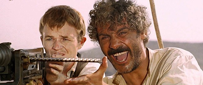 """EAT LEAD!:  Bill """"Niño"""" Tate and El Chuncho (Gian Maria Volonté) join forces to steal guns to sell to revolutionaries in A Bullet for the General, a classic Zapata Western, which is a subgenre of Spaghetti Westerns. - PHOTO COURTESY OF M.C.M."""