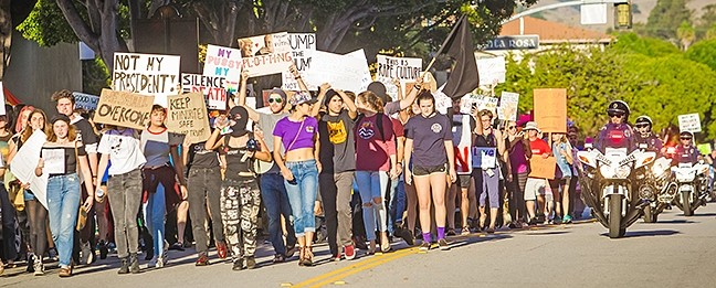 """IN THE STREETS:  Chants of """"Love Trump's Hate!"""" and """"This is what democracy looks like!"""" filled the air as protestors marched on downtown SLO Nov. 12. - PHOTO BY JAYSON MELLOM"""