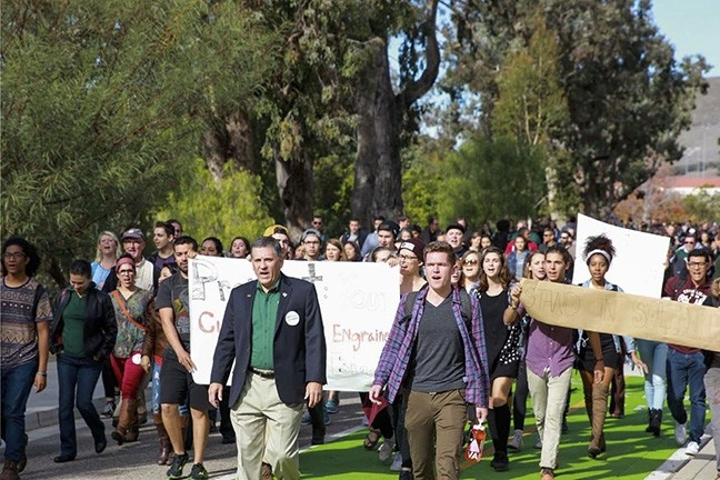 NO PLACE FOR HATE:  Cal Poly President Jeffrey Armstrong (left) and junior Matt Klepfer lead a march through campus in December after a SLO Solidarity leader received a death threat from a peer. - PHOTO COURTESY OF CAL POLY