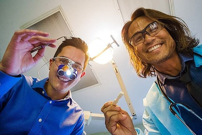 DON'T BE SCARED :  It's just your friendly neighborhood dentists with perfect teeth, Dr. Nathan Wong (left) and Dr. Mattew Kim (right), and the best dental practice. - PHOTO BY JAYSON MELLOM