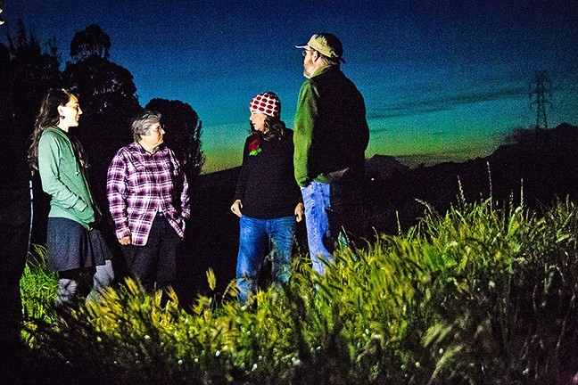 SENSITIVE HABITAT :  Mary Ciesinski, executive director of ECOSLO; Carolyn Huddleston, ECOSLO docent; Heidi Harmon, SLO mayor; and Evan Albright, docent, (left to right) discuss the issue of night hiking at Laguna Lake Park. - PHOTO BY JAYSON MELLOM