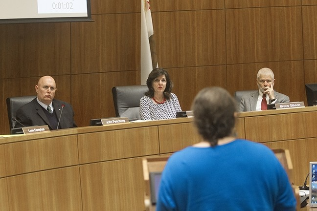 WATER POLITICS :  Pictured left to right, SLO County supervisors Debbie Arnold, John Peschong, and Bruce Gibson listen to public comments about the county's water policies on March 21. - PHOTO BY JAYSON MELLOM