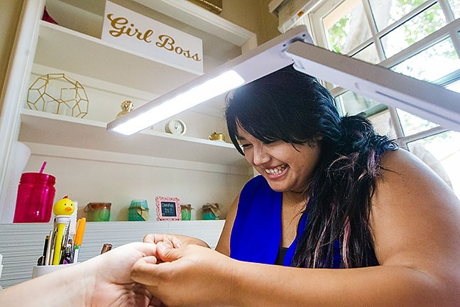 NAIL ARTIST:  Pinkies Up owner Yessie Nojas can get those nails looking pretty friggin' sweet, and our readers believe her skills are the best in SLO County. - PHOTO BY JAYSON MELLOM