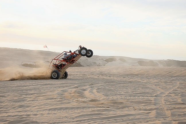 DUSTY TRAILS The California Coastal Commission approved a five-year plan by State Parks officials to try and mitigate dust at the Oceano Dunes State Vehicular Recreation Area. - PHOTO BY STEVE E. MILLER