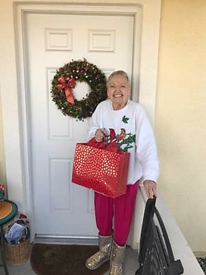 SPREADING JOY Dressed to impress in her holiday gear, Eden received a gift from the Be a Santa to a Senior program. - PHOTO COURTESY OF GINA PERRAULT