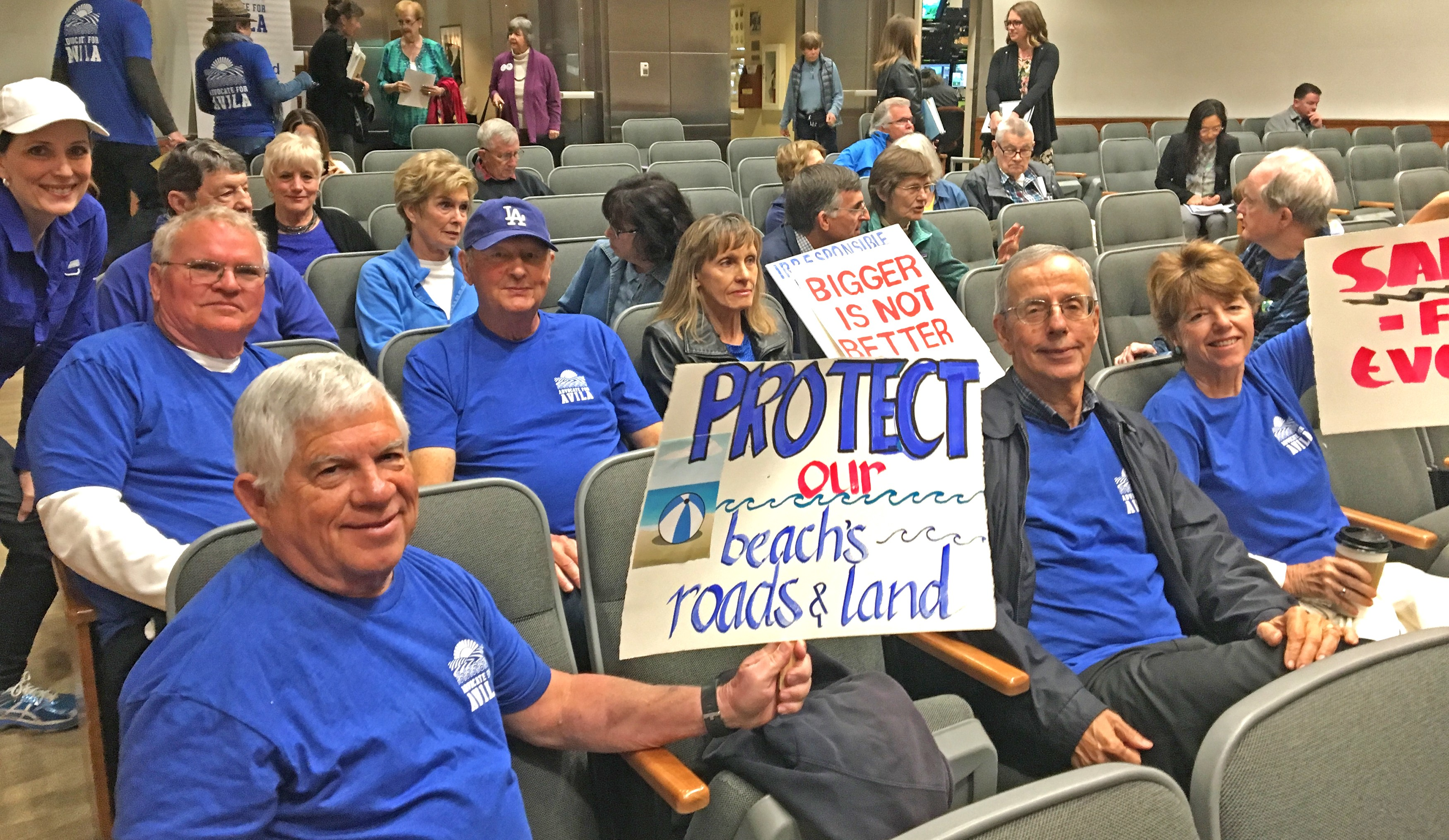 ON THE LOOK OUT Avila Beach residents showed up to the April 17 SLO County Board of Supervisors meeting to voice their disagreement with large development in the area. - PHOTO COURTESY OF BETTY HARTIG