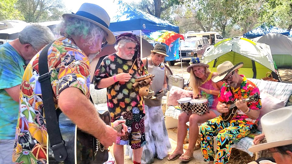 EVERYBODY JAM NOW Live Oak emcee Joe Craven (seated far right) wandered into Camp Ba'ar Nekkid and joined an impromptu jam. - PHOTO COURTESY OF KELLY MCCLEARY