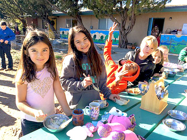 FOOD AND FUN Santa Lucia School students enjoy their lunch and play outside. - PHOTO COURTESY OF STACY BURK