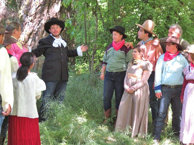 POLITICAL DANCE Senator Beauregard (Jason Cantu, center) tries to drum up support for his re-election among the townsfolk of Dairy Gulch. - PHOTO COURTESY OF SEAN MCALPINE