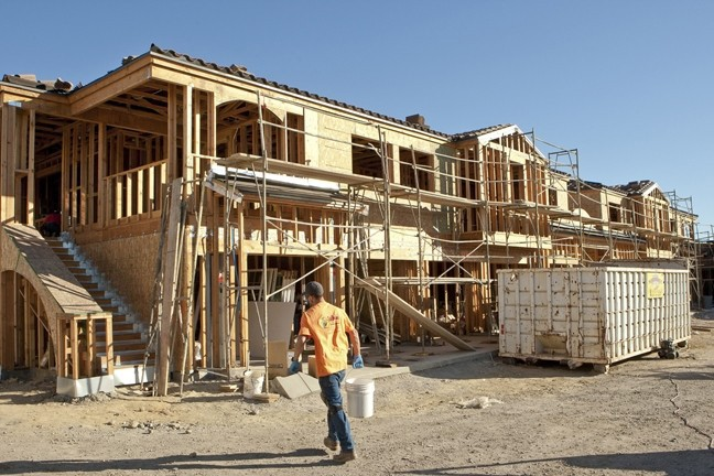 ROOFS OVER HEADS SLO County supervisors signed off on a three-year plan to boost funding for affordable housing, like the Las Lomas apartments in Atascadero (pictured under construction in 2013). - FILE PHOTO BY STEVE E. MILLLER