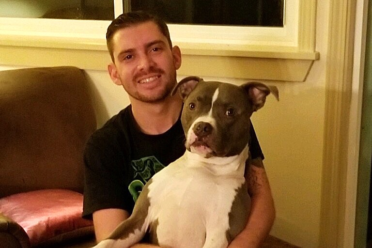 DEADLY SHOOTING Bubbs, a 7-year-old pit bull-boxer mix, was shot and killed by a SLO police officer on Sept. 26. His owners, Nick Regalia (pictured) and Riley Manford, plan to sue the city in response. - PHOTO COURTESY OF NICK REGALIA