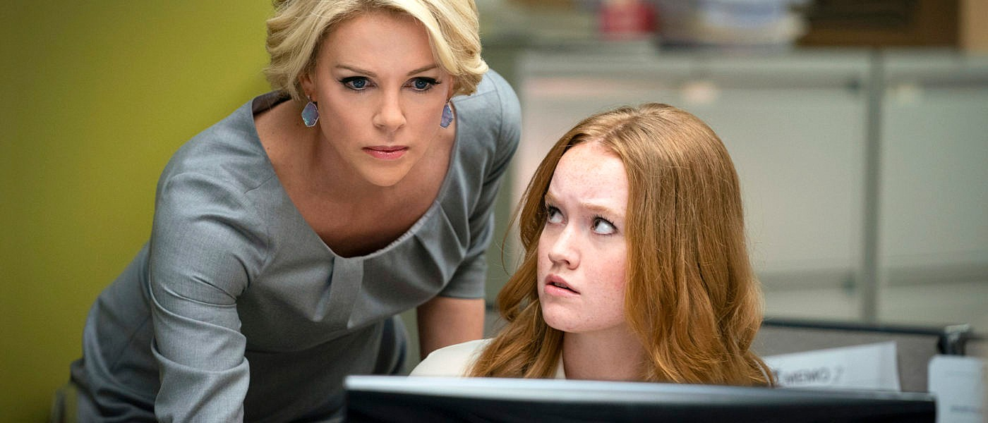 START SPREADING THE NEWS Megyn Kelly (Charlize Theron) and her assistant, Lily (Liv Hewson), react to the revelation that Gretchen Carlson has accused Fox News CEO Roger Ailes of sexual harassment. - PHOTOS COURTESY OF LIONSGATE