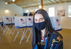 """PHOTO BY JAYSON MELLOM - HELPING VOTERS Mission Prep High School Senior Maddie Haddad volunteered to work two days at the San Luis Obispo Octagon Barn's Vote Service Center. She called the experience """"extremely gratifying."""""""