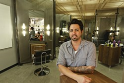 PHOTO BY STEVE E. MILLER - SCISSORHANDS :  Carlos Sosa, owner of the newly opened Fierro Salon, wants to transform people's hair—and, by extension, their lives.