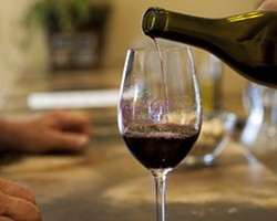 PHOTOS BY STEVE E. MILLER - RED POUR :  The tasting room has two red wines and two white wines to sample.
