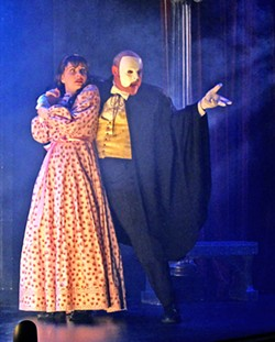 PHOTO COURTESY OF THE GREAT AMERICAN MELODRAMA - THINK OF THEM Franklin (Tim Stewart) fights to save his true love Christine (Katie Worley Beck, left) from the Phantom (Beau Heckman, right) in the Great American Melodrama's production of The Phantom of the Melodrama.