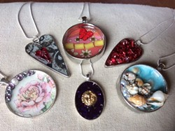 Design two necklaces and encase them in resin. - Uploaded by Joan Martin Fee