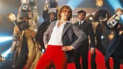 PHOTOS COURTESY OF MARV FILMS - FAME'S DARK SIDE Elton (Taron Egerton, center) poses for the cameras as his manager and lover, John Reid (Richard Madden, right), looks on.