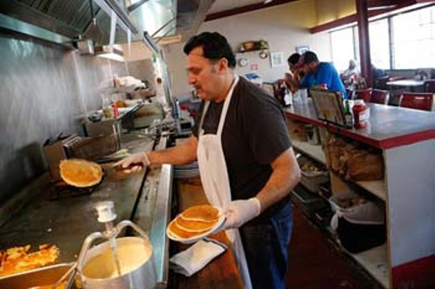 Saul Rodrigues cooks pancakes at Jimmy's Egg in Oklahoma City, Thursday, April 16, 2015.  (Garett Fisbeck) - GARETT FISBECK