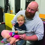 Kevin Hammond, a candidate for Cleveland County sheriff, and his 2-year-old daughter Rori attended Warren's speech and talked to <i>Oklahoma Gazette</i> about students' need for good healthcare in order to focus on their studies.