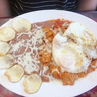 <i>Chilaquiles</i> with eggs and red sauce