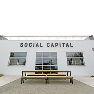 Social Capital is located on Hudson Avenue, across from the western edge of Scissortail Park.