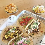 <i>Al pastor</i>, beer-can chicken, <i>cotija</i> and <i>carne asada</i> tacos with Nashville hot fried cauliflower and <i>elote</i> roasted corn at Social Capital