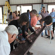 OKC Metro Alliance hosted a beam signing for Women's Firstep's new kitchen and dining room being built with funds from the Impact Oklahoma grant.