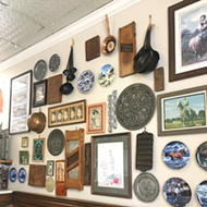 The walls inside The Brown Bag Deli are filled with Americana items.