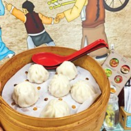 "Soup dumplings are listed on the menu at Yummy Noodles as ""little juicy pork buns."""