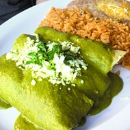 Chicken <i>enchiladas</i> with a poblano and sour cream sauce