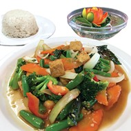 A lunch offering of vegetable stir-fry with <i>tofu</i> in Thai basil sauce