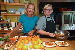 Kamala Gamble, left, with her chef Barbara Mock during food prep in her home recently.  mh