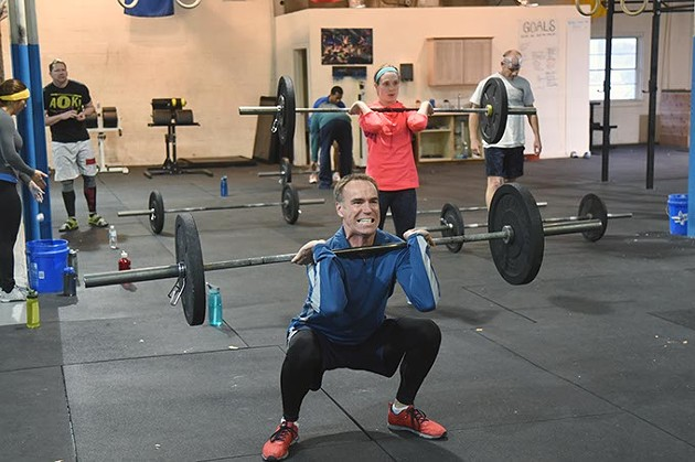 Patrons get into lifting barbells at all different weight levels at 405 CrossFit recently.  mh