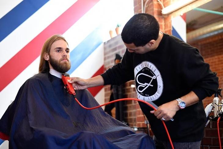 Phillip Jordan trims Joseph Thornburg's beard at Fitzgerald Barber & Supply, Tuesday, March 15, 2016. - GARETT FISBECK