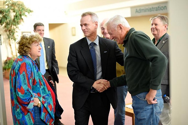 Congressman Steve Russell shakes hands with Don Spurgin before a town hall meeting at The Village Municipal Building, Tuesday, March 8, 2016. - GARETT FISBECK