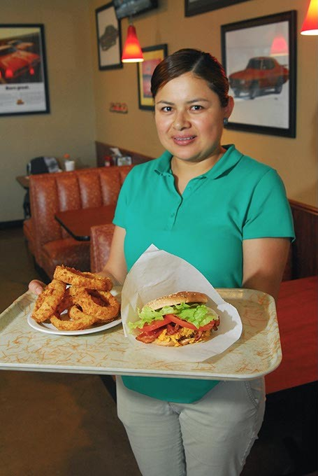 Eva Trejo Acevedo with a tray of goodies, the bacon cheeseburger and onion rings will be featured at Taste of Midwest City, from Judge's Char Grill.  mh