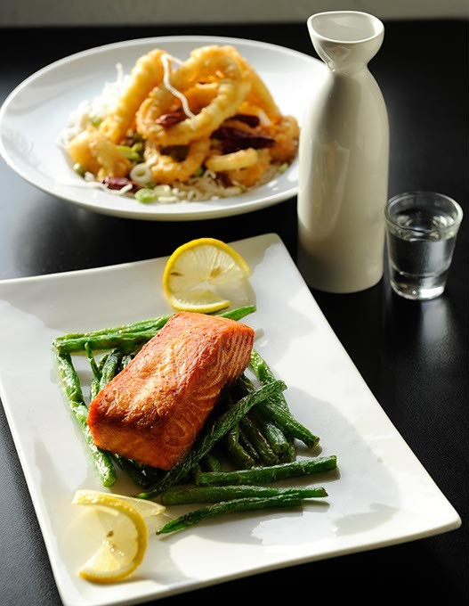 Crispy Calamari and wok-seared salmon with a bottle of Gekkeikan Nigori at Kang's Asian Bistro in Edmond, Tuesday, Jan. 13, 2015. - GARETT FISBECK