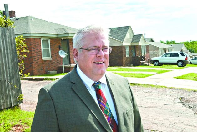 Mark Gillett, executive director for the Oklahoma City Housing Authority, on the scene at the public housing project they are calling the northeast duplexes, a large area containing at least 4 streets, including N.E. 27th where he is pictured.