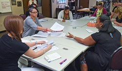 Women participants in the ReMerge program work at the non-profit's new facilities inside the building which houses Northcare, at 1140 N. Hudson Avenue.  mh