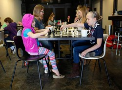 Harper Ruhl and Angela Reid during a ladies' chess club meeting at District House in Oklahoma City. (Garett Fisbeck)