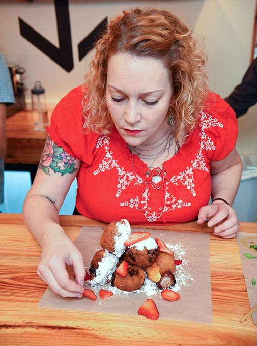 Beth Lyon, the chef at Anchor Down puts together a stack of strawberry fritters for a photo shoot and tasting at the new restaurant.  mh
