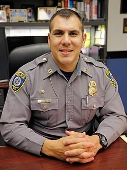 """OKC Police Captain Juan """"Paco"""" Balderrama poses for a photo in Oklahoma City, Wednesday, April 15, 2015. - GARETT FISBECK"""