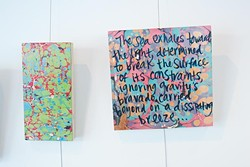 Kerri Shadid, Skirvin Hilton's Artist-in-Residence, creates poems on paintings, shown on the wall of her Skirvin studio.  mh