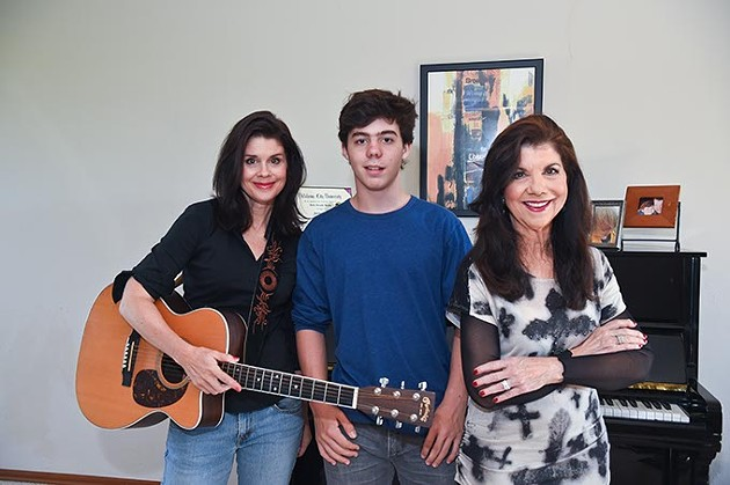 From left, Robin Brooks, Montana Sullivan, and Jody Miller, pose in Robin's Blanchard home music room.  mh