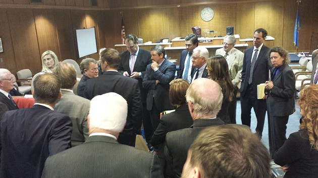 Dozens of lawyers gathered following a Wednesday hearing involving a lawsuit against hundreds of restaurants concerning alcohol taxes. - BEN FELDER
