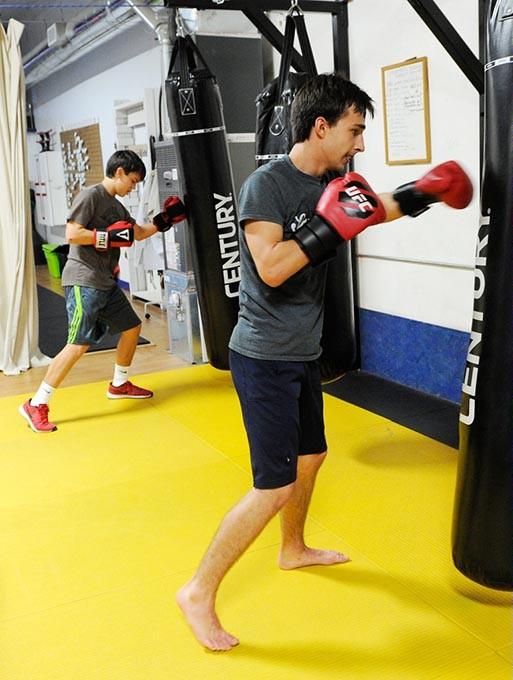 Maxium Lujan, left, and Anton Barykin during a kickboxing class at Conan's Kick Boxing Karate Academy in Norman, Thursday, Jan. 7, 2015. - GARETT FISBECK