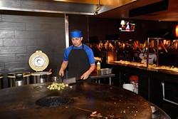 Christopher Lopez cooks Mongolian BBQ at Fuze, Monday, April 4, 2016. - GARETT FISBECK