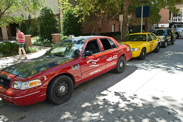 Cabs lined up waiting for rides along Main Street in Downtown OKC. - MARK HANCOCK